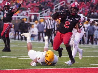 Oct 19, 2019: Utah Utes running back Zack Moss (2) scores on a one yard touchdown run against Arizona State Sun Devils safety Aashari Crosswell (16) and linebacker Merlin Robertson (8) in the second quarter at Rice-Eccles Stadium.