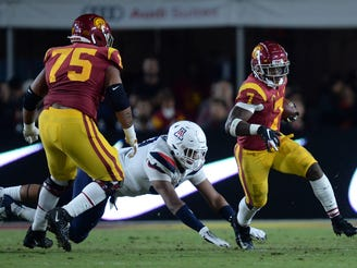 October 19, 2019; Los Angeles, CA, USA; Southern California Trojans running back Stephen Carr (7) runs the ball against the Arizona Wildcats during the first half at the Los Angeles Memorial Coliseum.