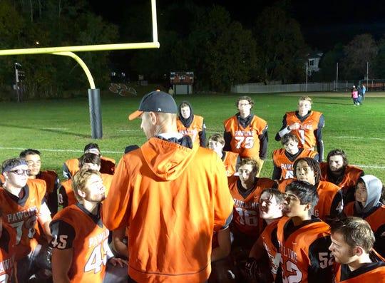 The Pawling football team huddles around coach Jason Kuhlmann after beating Pine Plains/Rhinebeck on Saturday.