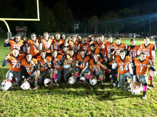 The Pawling football team poses for a photo on Oct. 19 after beating Pine Plains/Rhinebeck to clinch the No. 1 seed entering the 8-man football playoffs.