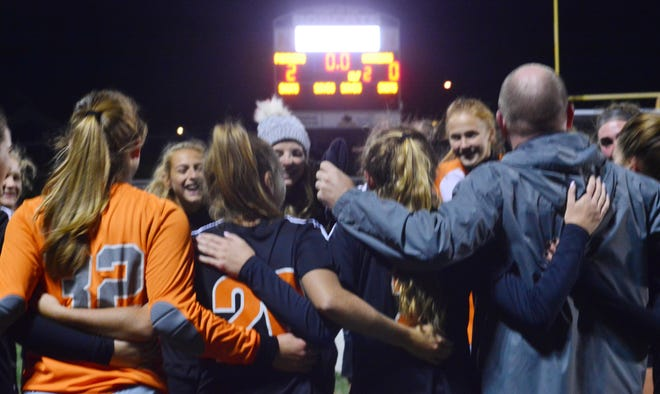 Central York celebrates after winning the York-Adams League girls' soccer title on Saturday night.