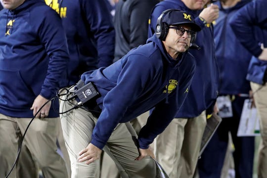 Michigan head coach Jim Harbaugh stands on the sidelines during the first half of an NCAA college football game against Penn State in State College, Pa., Saturday, Oct. 19, 2019. (AP Photo/Gene J. Puskar)