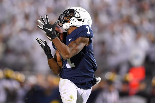 Oct 19, 2019; University Park, PA, USA; Penn State Nittany Lions wide receiver KJ Hamler (1) catches a pass on his way for a touchdown against the Michigan Wolverines during the fourth quarter at Beaver Stadium. Mandatory Credit: Rich Barnes-USA TODAY Sports