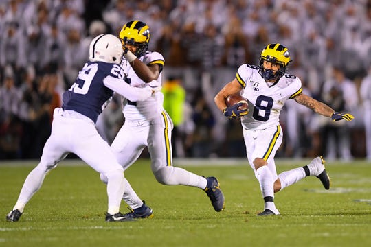 Oct 19, 2019; University Park, PA, USA; Michigan Wolverines wide receiver Ronnie Bell (8) runs with the ball against the Penn State Nittany Lions during the first quarter at Beaver Stadium. Mandatory Credit: Rich Barnes-USA TODAY Sports