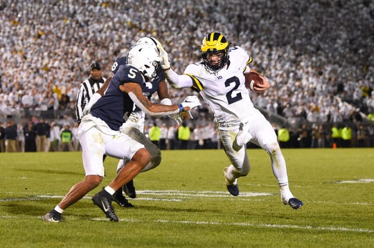 Michigan quarterback Shea Patterson stiff-arms Penn State cornerback Tariq Castro-Fields in the fourth quarter Saturday.