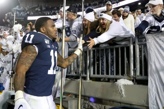 Oct 19, 2019; University Park, PA, USA; Penn State Nittany Lions linebacker Micah Parsons (11) shakes the hands of students following the completion of the game against the Michigan Wolverines at Beaver Stadium. Penn State defeated Michigan 28-21. Mandatory Credit: Matthew O'Haren-USA TODAY Sports