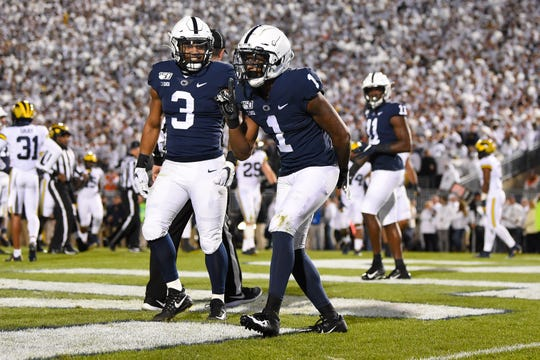 Penn State Nittany Lions wide receiver KJ Hamler (1) celebrates his touchdown reception against the Michigan Wolverines during the second quarter at Beaver Stadium.