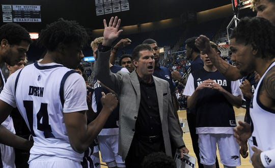 Nevada head coach Steve Alford encourages his players as they take on Cal State East Bay during their basketball game at Lawlor Events Center in Reno on Oct. 19, 2019.