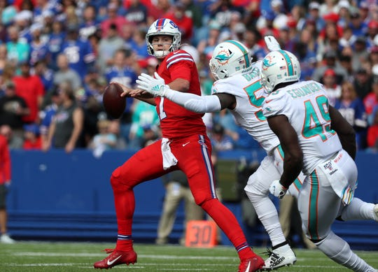 Bills quarterback Josh Allen  is pressured as he looks downfield against Miami.