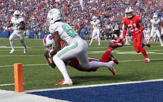 Bills cornerback Tre'Davious White makes a diving interception near the goal line to stop a Miami drive. The play helped the Bills win 31-21.