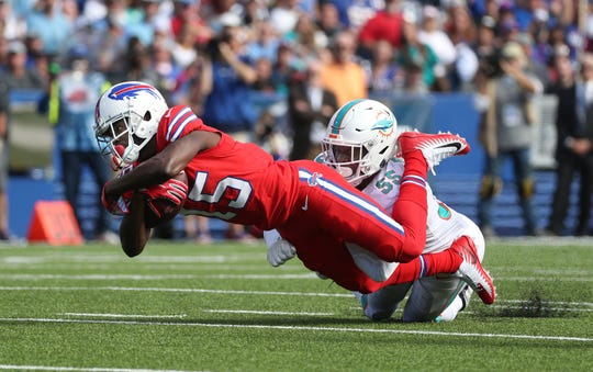 Bills receiver John Brown dives for extra yards against the Dolphins.  Brown had five receptions for 83-yards and a touchdown in a 31-21 win over Miami.