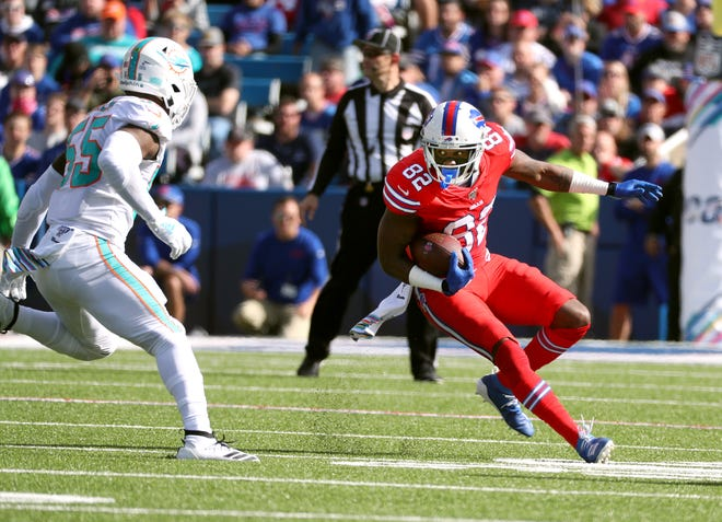 Bills Duke Williams looks for yards after a catch.