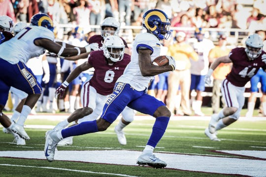 Angelo State University receiver Keke Chism picks up yardage against West Texas during a Lone Star Conference game at Buffalo Stadium in Canyon Saturday, Oct. 20, 2019. The Rams won a thriller 17-14.
