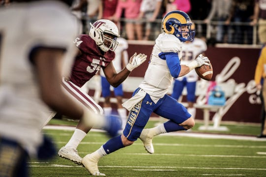 Angelo State University quarterback Payne Sullins scrambles for yardage during a Lone Star Conference game against West Texas A&M at Buffalo Stadium in Canyon Saturday, Oct. 20, 2019.