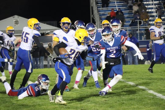 Baltic's Brenden Allen rushes against Parker on Oct. 11.