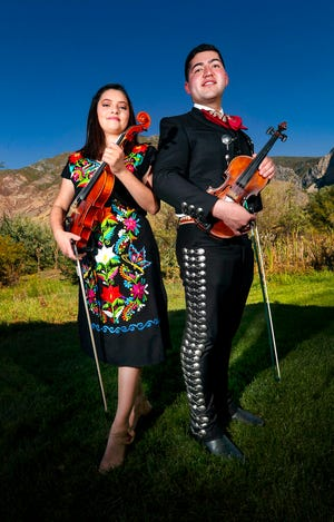 Karlysue Castillo Pereyra and her brother, Sam Castillo, are pictured at Pereyra's home in Springville, Utah on Tuesday, Sept. 24, 2019. The two, who have played at weddings, festivals and corporate events since they were children, formed their own group in 2016.  (Steve Griffin/The Deseret News via AP)