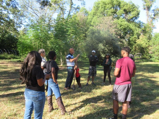 A group discussion at the  iGrow-TFN Community Garden on Dent Street.