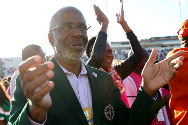 Florida A&M President Larry Robinson celebrates with the football team after they defeated North Carolina A&T State 34-31 in overtime at Bragg Memorial Stadium Sunday, Oct. 20, 2019.