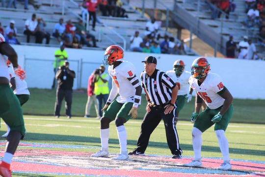 FAMU safety Markquese Bell (left) and linebacker Elijah Richardson read South Carolina State's offensive alignment.