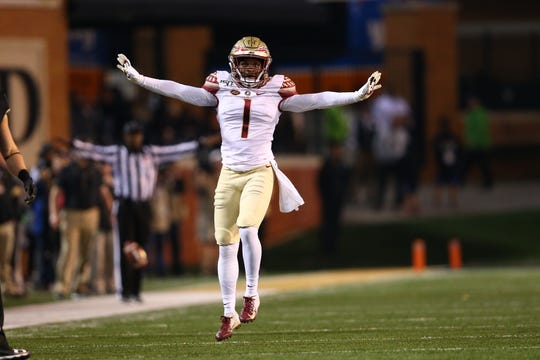 Oct 19, 2019; Winston-Salem, NC, USA; Florida State Seminoles defensive back Levonta Taylor (1) celebrates a pass break up in the second quarter against the Wake Forest Demon Deacons at BB&T Field. Mandatory Credit: Jeremy Brevard-USA TODAY Sports