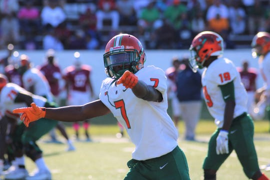 FAMU wide receiver George Webb checks with the sideline official before the snap during the game versus South Carolina State.
