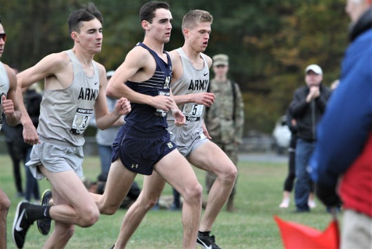 Alex Rizzo (c) of the U.S. Naval Academy and formerly of Bronxville High runs against Army at Bowdoin Park in Wappingers Oct. 18, 2019 during the Army vs. Navy Star Meet.