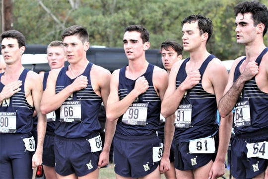 Alex Rizzo (99) sings Naval Academy alma mater with teammates after his men's cross-country team beat Army at Bowdoin Park in Wappingers Oct. 18, 2019.
