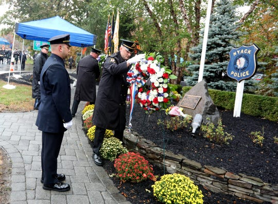 """Police officers present wreaths during the annual commemoration honoring Nyack Police Sgt. Edward O'Grady, Nyack Police Officer Waverly """"Chipper"""" Brown, and Brinks guard Peter Paige on the 38th anniversary of the Brinks Robbery in Nyack Oct. 2o, 2019. O'Grady, Brown, and Paige were killed in the robbery attempt, which took place at the intersection of route 59 and Mountainview Road in Nyack on Oct. 20, 1981."""
