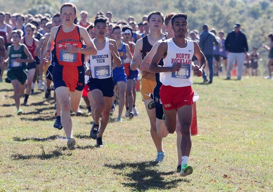 North Rockland's Daniel Shepard leads the pack at the start on his way to winning the Boys Varsity 2 race at the Coaches Cross- Country Invitational varsity races at Bowdoin Park in Wappingers Falls  Oct. 19, 2019.