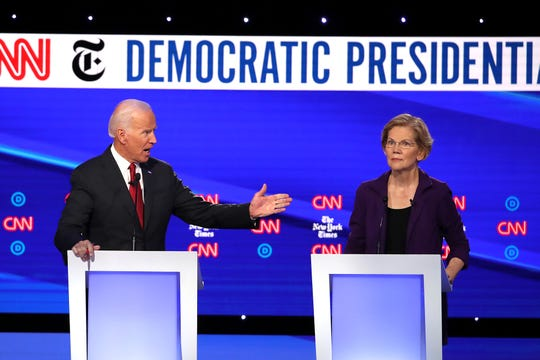 Former Vice President Joe Biden challenges U.S. Sen. Elizabeth Warren, D-Mass., during the Democratic Presidential Debate at Otterbein University on Oct. 15, 2019, in Westerville, Ohio. A record 12 presidential hopefuls participated in the debate hosted by CNN and The New York Times.