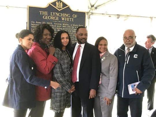"""(from left) Sen. Elizabeth """"Tizzy"""" Lockman, Rep. Kendra Johnson, Savannah Shepherd, Sen. Darius Brown, Rep. Sherry Dorsey Walker and Rep. Franklin Cooke pose in front of new marker memorializing the lynching of George White on Sunday, Oct. 20, 2019."""