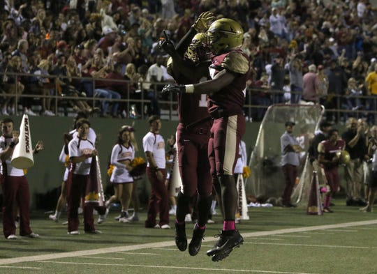 Midwestern State's Kylan Harrison, right, celebrates his touchdown with Tyrique Edwards in the game against Texas A&M-Kingsville Saturday, Oct. 19, 2019, at Memorial Stadium.