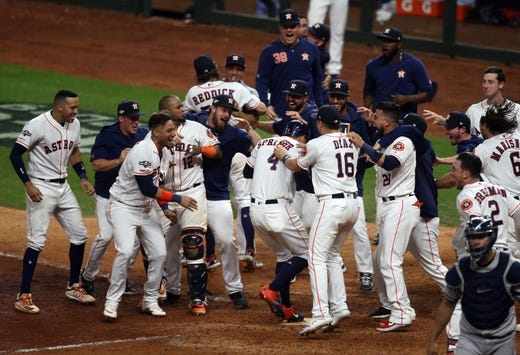 Game 6 - Jose Altuve is mobbed by his teammates after his walk-off home run in the ninth inning.