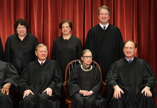 Associate Justice Brett Kavanaugh, top right, towers over his colleagues in this photo and is better known, following his contentious Senate confirmation battle last year, according to a poll by Marquette University Law School. Associate Justice Ruth Bader Ginsburg, seated, is a close second.