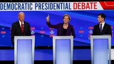 Democratic presidential candidate former Vice President Joe Biden, left, Sen. Elizabeth Warren, D-Mass., and South Bend Mayor Pete Buttigieg, right, participate in a Democratic presidential primary debate hosted by CNN/New York Times at Otterbein University, Tuesday, Oct. 15, 2019, in Westerville, Ohio. (AP Photo/John Minchillo)