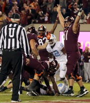 Virginia Tech players cerebrate their win over North Carolina.