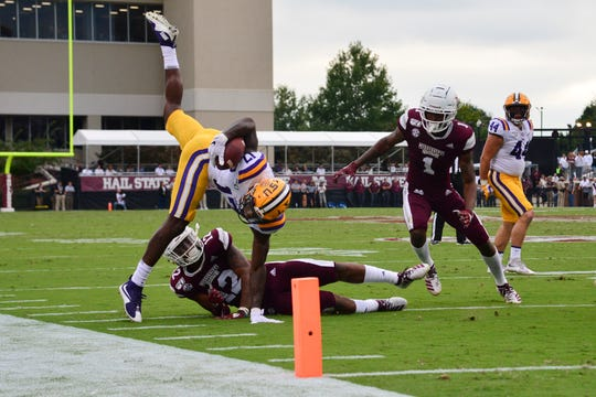 LSU Tigers  wide receiver Racey McMath (17) is knocked out of bounds by Mississippi State Bulldogs safety Shawn Preston Jr. (12) and cornerback Martin Emerson (1) during the third quarter at Davis Wade Stadium.