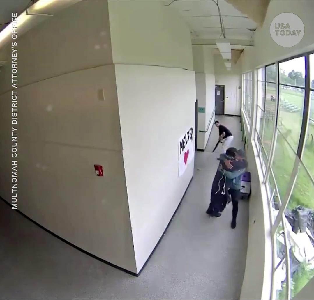 usatoday.com - John Bacon, USA TODAY - Oregon coach Keanon Lowe takes gun from high school student, hugs him in viral video