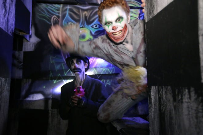 A pair of ghouls pop out to scare visitors at the Burial Chamber in Neenah in 2017.