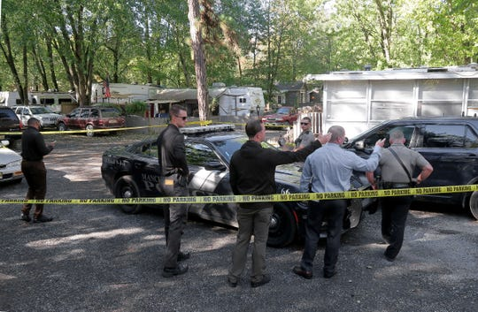 Manchester Township police and Ocean County investigators are shown Monday morning, October 21, 2019, at the scene of a Sunday night murder at the Surf & Stream campground in the township.