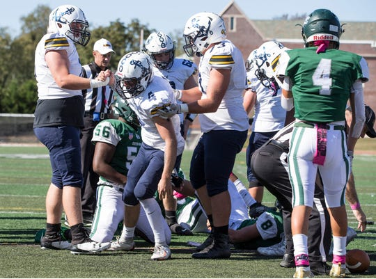 Toms River North's Matt Spalletta (No. 4, shown being congratulated by his teammates after he scored a touchdown in the Mariners' wild 43-39 win at Long Branch is one of the candidates fans can vote for in the Asbury Park Press Shore Conference Player of the Week.