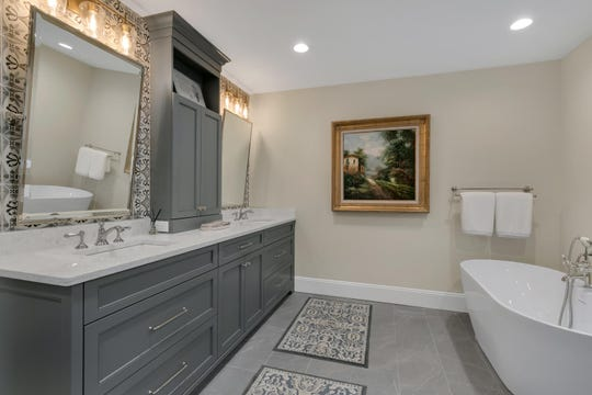 The master bathroom features soaking tub, large shower and double vanity
