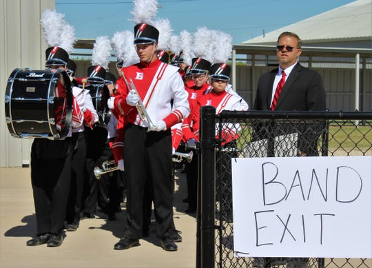 "Baird High School band director Gary Sherman stands with his student musicians before they entered Bulldog Stadium on Monday to compete at the UIL regional contest. Baird earned a ""1"" rating to advance to the state contest for the first time in years."