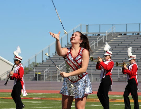 "Senior Kydie Edwards twirls during Albany High School's UIL marching band competition at Wylie ISD's Bulldog Stadium. Albany was judged with a ""3"" raring."