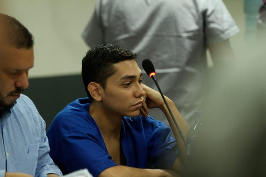 In this Oct. 11, 2019 photo, lawyer Eduardo Rubi, left, appears in court with his client Orlando Tercero in Managua, Nicaragua.  Moreno is accused of killing 22-year-old U.S. nursing student Haley Anderson in 2018.