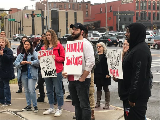 A group held a rally outside Binghamton City Hall on Monday, Oct. 21, 2019. They were supporting the four people charged with disrupting the city's Columbus Day parade.
