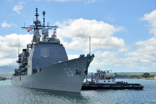 The Ticonderoga-class guided-missile cruiser USS Chosin prepares to moor at Joint Base Pearl Harbor-Hickam in 2014. The Chosin will be coming to Seattle for a major overhaul at Vigor Shipyards.