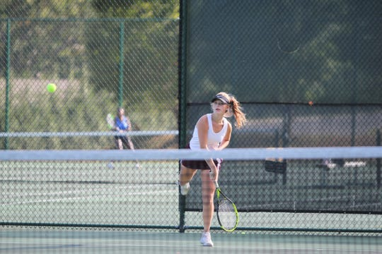 Owen senior and Warlassies co-captain Summer Thoma returns a serve against Sidney Ross of Lake Norman Charter, Oct. 16, as her team falls in the opening round of the state playoffs.