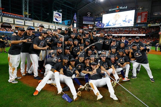 Houston Astros pose after winning Game 6 of baseball's American League Championship Series against the New York Yankees Saturday, Oct. 19, 2019, in Houston. The Astros won 6-4 to win the series 4-2.