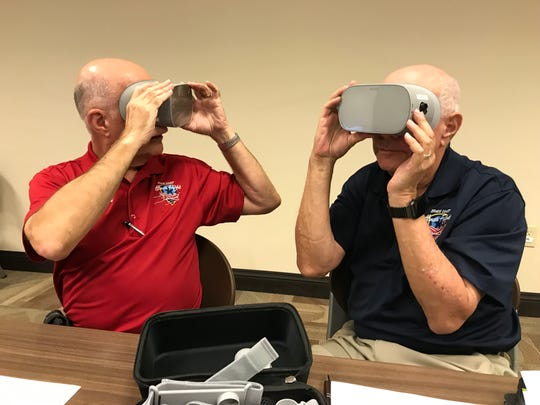 Lou Seiler, Space Coast Honor Flight videographer, and Stu Glass, marketing and public relations director for Space Coast Honor Flight, watch the virtual reality tour of a recent Honor Flight trip to Washington D.C.